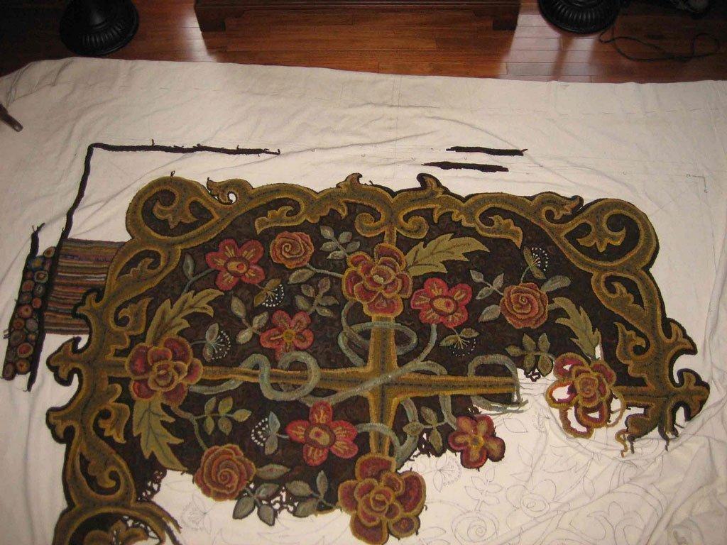 progress made on room sized hooked rug