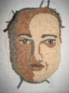 Wide cut rug hooked face roughly done