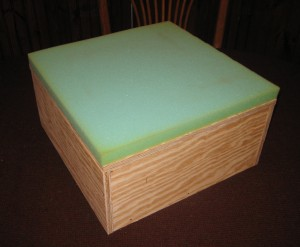 Step 1 adding foam to rug hooked footstool