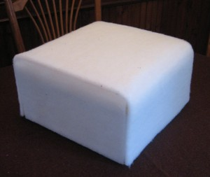 Foam added to rug hooked footstool frame